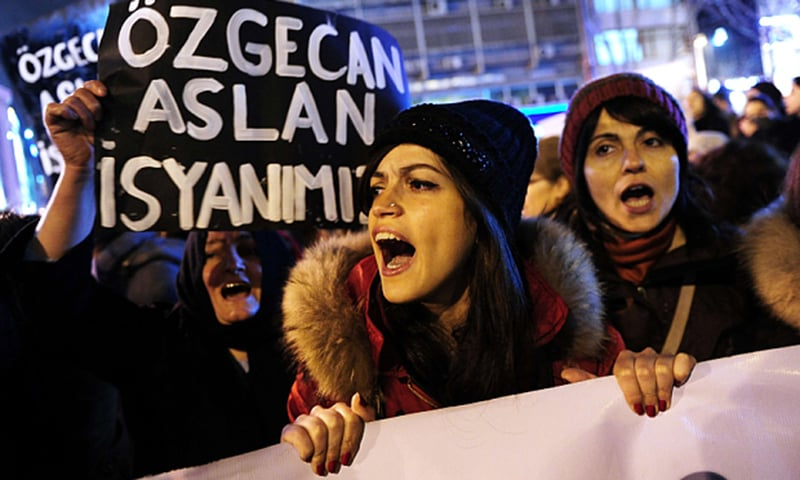 A woman shouts slogans during a demostration in Istanbul, against the murder of a young woman named Ozgecan Aslan. -AFP