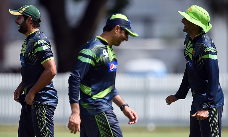 Pakistani cricketers Shahid Afridi (L), captain Misbah-ul Haq (C) and Younis Khan share a light moment during their training session at the Alan Border field ahead of the 2015 Cricket World Cup Pool B match between Pakistan and Zimbabwe in Brisbane on Feb 26, 2015. -AFP