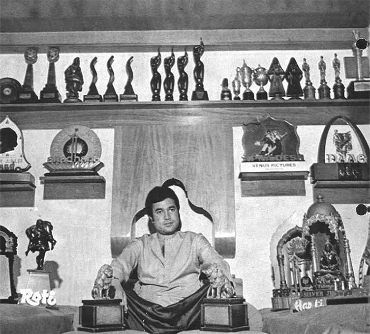 The superstar with his wall of trophies. Photograph courtesy: Super