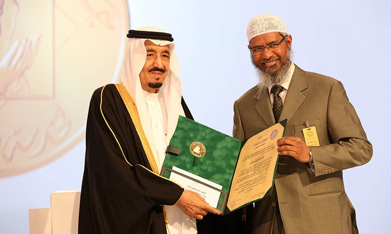 A handout picture released by the King Faisal Foundation on March 1, 2015 shows Saudi King Salman bin Abdul Aziz (L) presenting Zakir Naik, president of the Islamic Research Foundation in India, with the 2015 King Faisal International Prize for Service to Islam in Riyadh. — AFP
