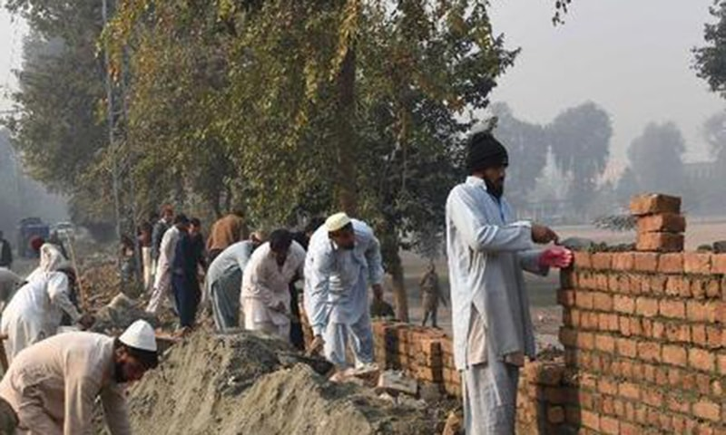 The initiative is part of the PM Housing Scheme under which poor people will be provided houses on easy instalments.—AFP/File