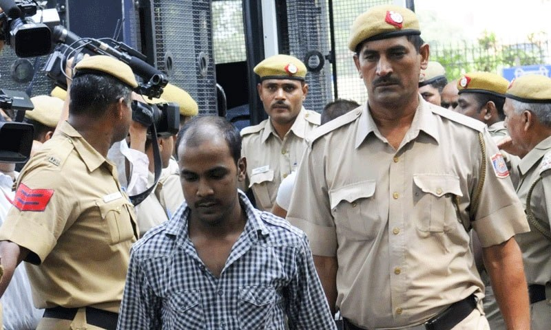 Mukesh Singh is escorted by the police inside the High Court. —AP/file