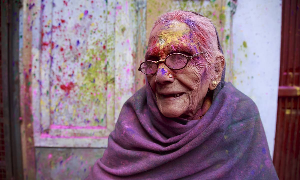 "Bindeshwari Devi, 92, says she has not only played Holi for the first time after her husband's death ""but I was also photographed for the first time in my life."""