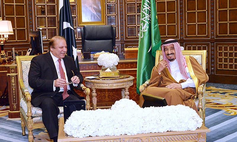 Prime Minister Nawaz Sharif talking to Saudi King Salman bin Abdulaziz at the King's Palace. —APP