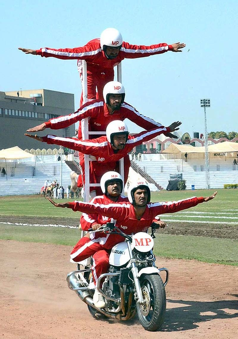 Personnel of Military Police performing acrobatics during full dress rehearsal of Horse and Cattle Show at Fortress Stadium. — APP