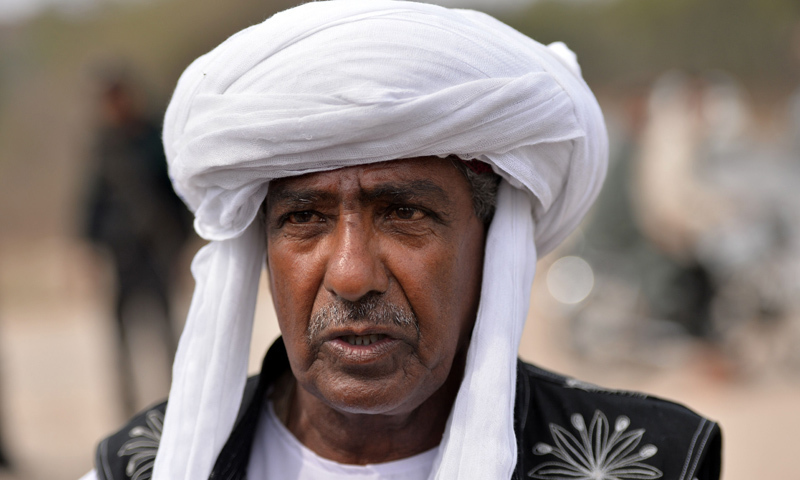 "Mama Qadeer says officials told him he was involved in ""anti-Pakistan"" activities, which is why he could not travel abroad. —AFP/File"