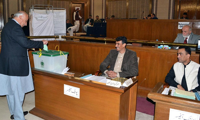 Chief Minister Balochistan Abdul Malik Baloch casting his vote during elections for the Senate. - Online