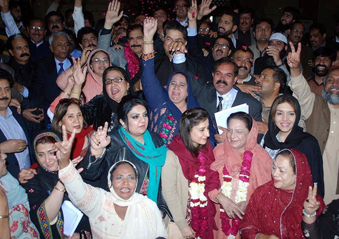 Supporters of PML-N celebrate the victory of Najma Hameed in Senate election outside Punjab Assembly. -  INP