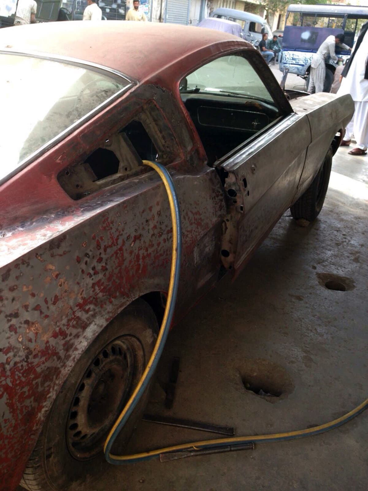 The 1965 ford mustang fastback in its dilapidated condition photo shakeel autos