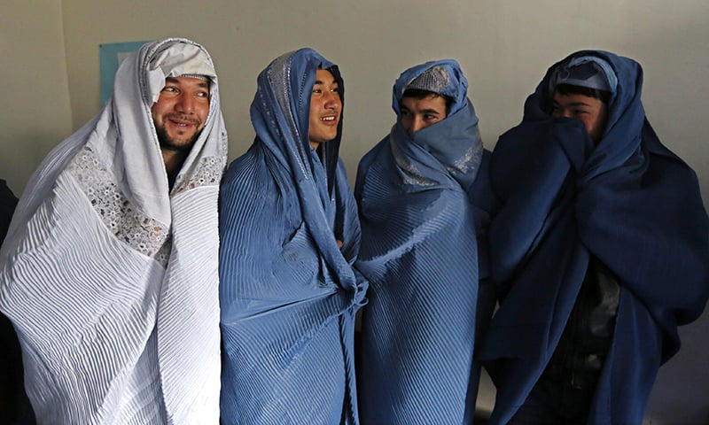 Male Afghan women's rights activists pose for media as they wear burqas to show their solidarity to Afghan women ahead of International Women's Day in Kabul, Afghanistan. — Reuters