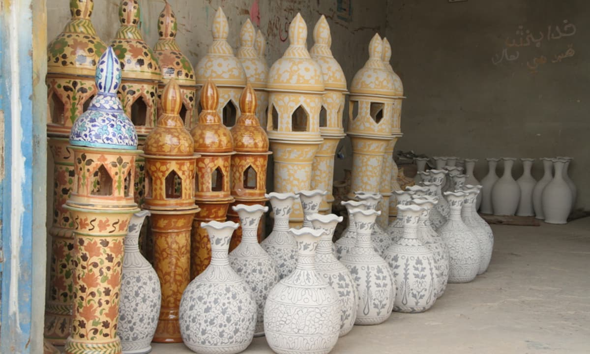 The Kashi art pottery is painted with the signature colours that include cobalt blue, turquoise, mustard, purple, brown and white.