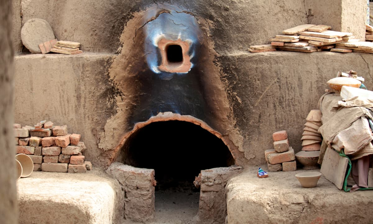 The furnace that uses mostly wood fire for fire baking and glazing pottery and tiles. Shaped pottery is fired for at least 15-20 hours at 800-900 degrees before it is ready for painting, glazing and then again firing to seal the glaze.