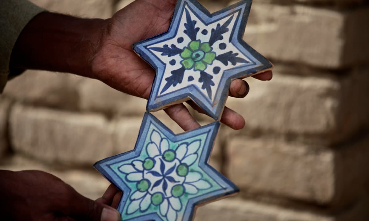 Each piece of tile is hand painted individually.