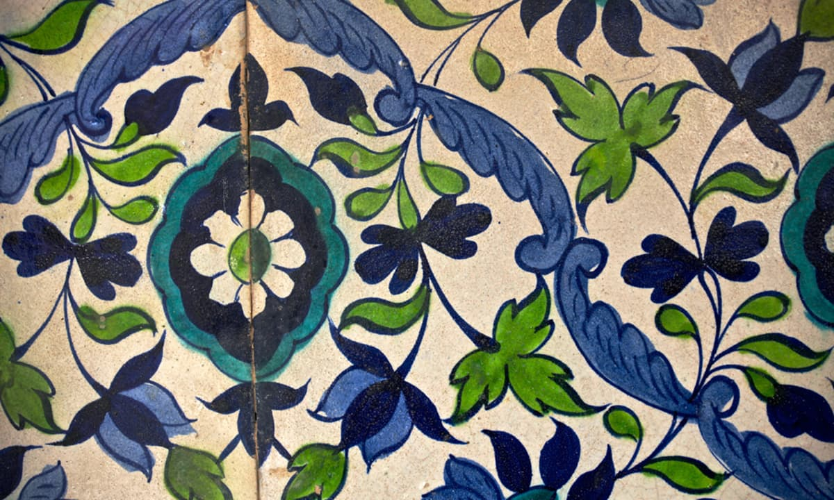 The tiles and utensils are designed and painted with beautiful flowers, leaves, geometric patterns and motifs.