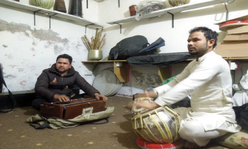 Some music shops also offer singing and instrument classes. Young men practice their singing and tabla-playing skills in one portion of a shop.