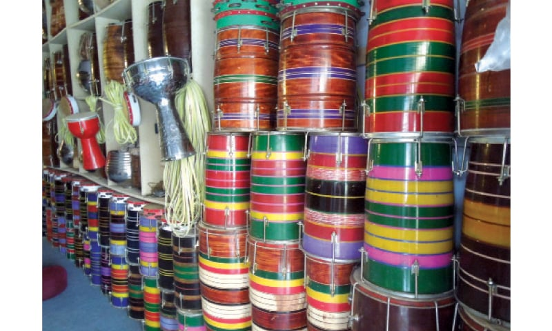 MUSICAL instruments such as tablas, tambourines and dholkis are arranged on shelves at shops on Shah Allah Ditta Road, Rawalpindi. — Photos by the writer