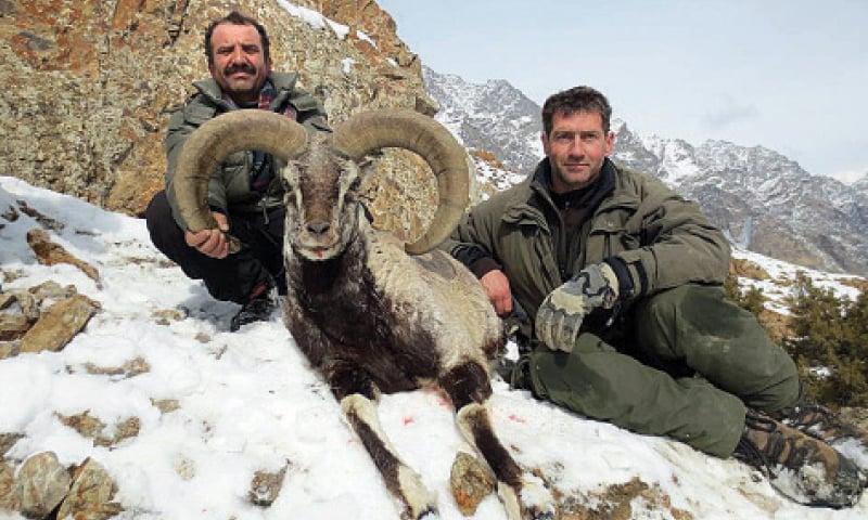 Italian hunter Boieti Gian Carlo along with his prized catch. — Dawn