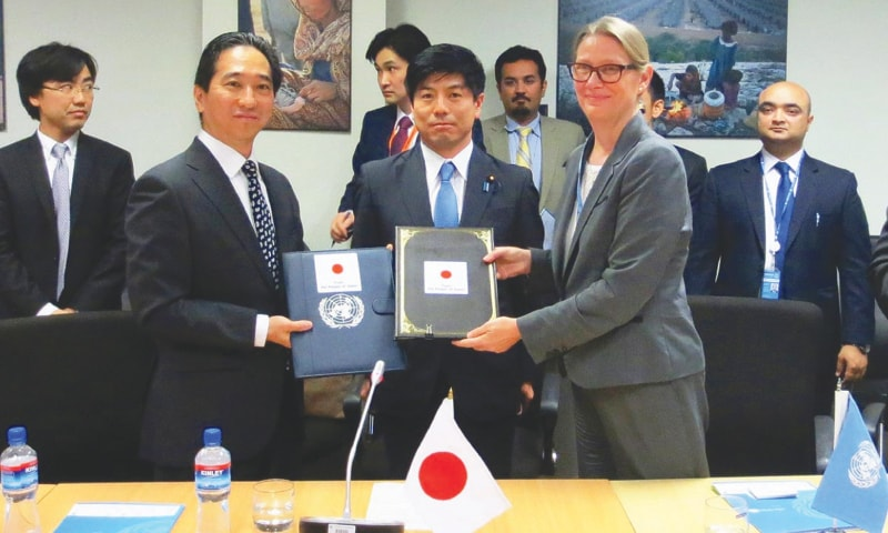 ISLAMABAD: Japan's charge d'affaires in Pakistan and Unesco's Representative in Islamabad Vibeke Jensen exchange signed documents for the installation of a flood warning system in Pakistan.—Online
