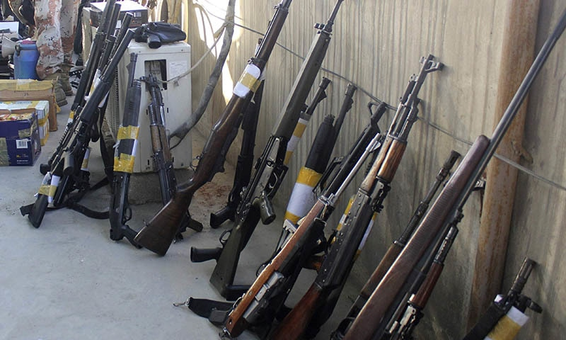 Weapons, recovered during a raid by paramilitary forces on MQM headquarters, are displayed for the media in Karachi March 11 2015. -Reuters