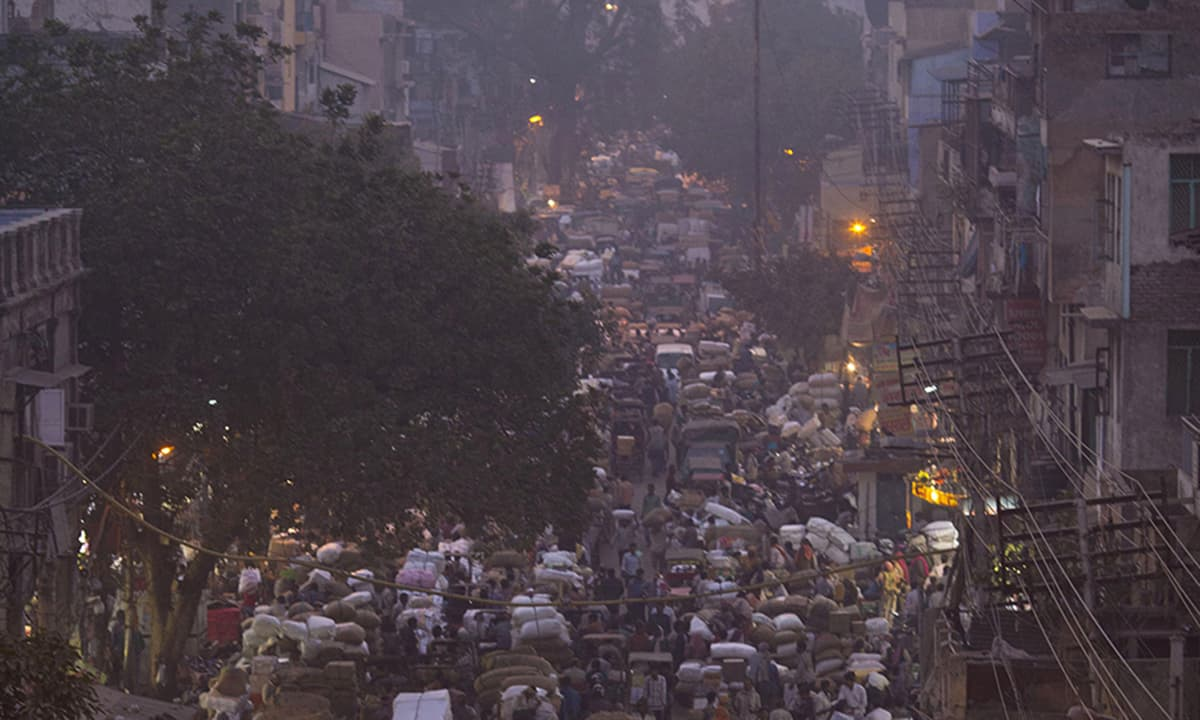 Hundreds of carts line up the main thoroughfare at khari Baoli, in New Delhi, India. The market is claimed to be the largest outdoor wholesale spice market in Asia with thousands of cart pullers operating in the maze of roads so small and crowded that trucks cannot get in during the day. — AP