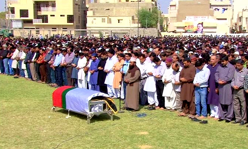 Funeral prayers being offered for MQM worker Waqas Ali Shah. — DawnNews screengrab