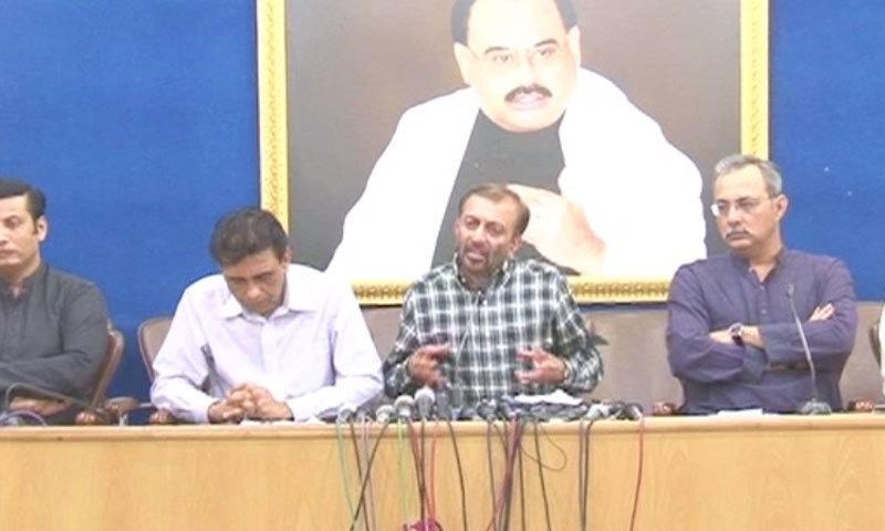 DawnNews screengrab show Dr Farooq Sattar addressing a press conference.
