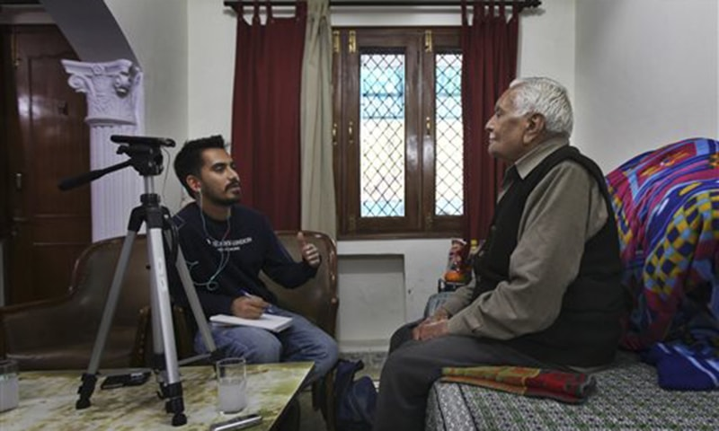 Prakhar Joshi, left, asks a question to 86-year old Desh Raj Kalra during an interview at his residence in New Delhi, India. Joshi has spent the last 15 months crisscrossing the country interviewing about 150 people to record oral histories including the partition of India. Often, this means listening to extremely personal stories of murder, rape and shattered families. —AP