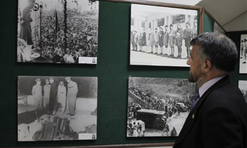 A man looks at pictures regarding the history of Pakistan's independence, displayed at a museum in Lahore, Pakistan. Partition marked a massive upheaval across the subcontinent. Hindus living for generations in what was to become Pakistan had to flee their homes overnight. —AP