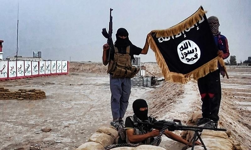 Islamic State (IS) militants at an undisclosed location.- AFP/File