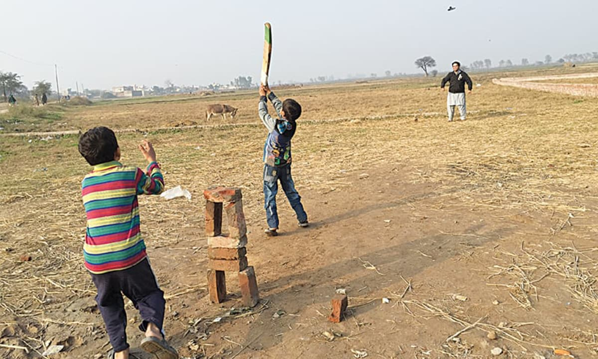 Kids playing cricket next to Puran's well.
