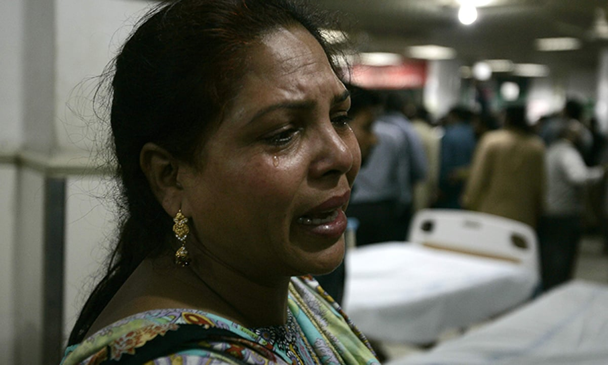 A woman cries at a hospital after her brother was injured in a suicide attack on a church in Lahore.—Reuters
