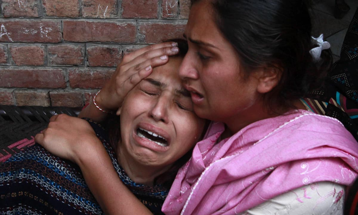 A woman mourns the death of her relative who was killed in a suicide attack on the church in Lahore.— Reuters
