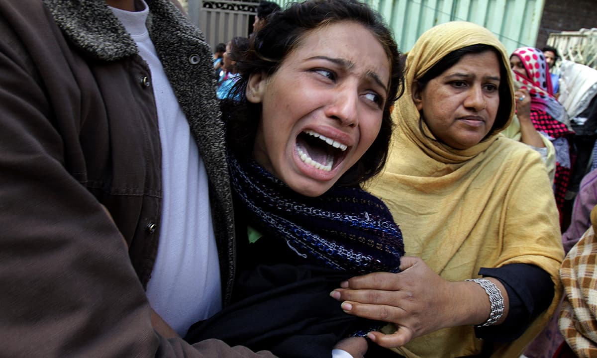 A woman mourns over a family member who was killed from a suicide bombing attack.— AP