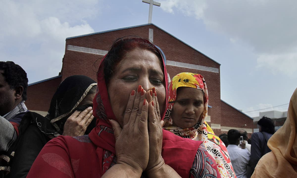 Christian women mourn as they gather at a church damaged from the bombing.— AP