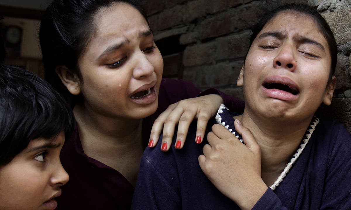 Christian girls mourn over a family member who was killed in the suicide bombing attack near two churches in Lahore.-AP