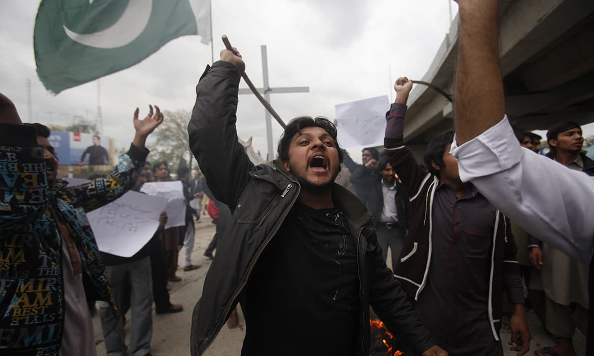 A member of the Pakistani community chants slogans during a protest rally in Peshawar, to condemn Sunday's suicide attacks on churches.— Reuters