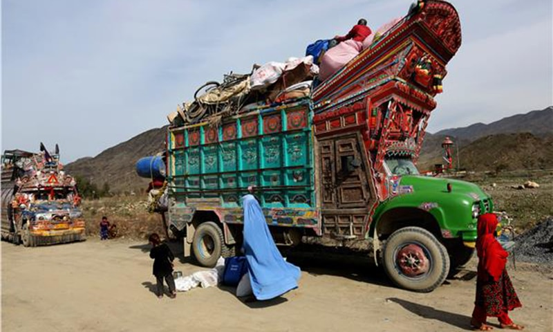 An Afghan refugee family return to Afghanistan through Pakistan's border crossing, Torkham, east of Kabul, Afghanistan.—AP