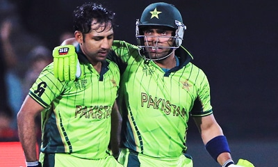 Brothers in arms. Umar Akmal, right, congratulates Sarfraz Ahmed after Pakistan's victory over Ireland. — AP