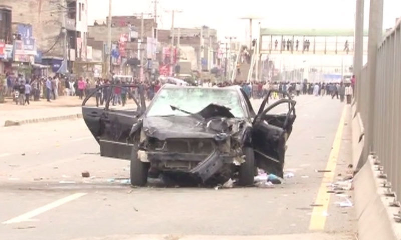 Car damaged as protest turns violent - DawnNews screen grab