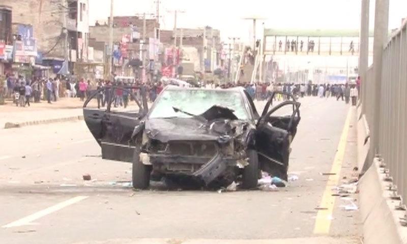 Car damaged as protest turns violent - DawnNews screen grab