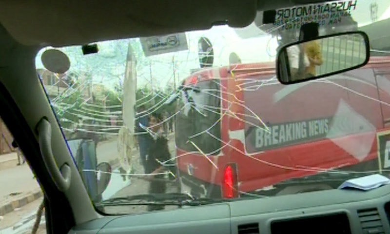 Demonstrators pelted stones as protest turned violent - DawnNews screen grab