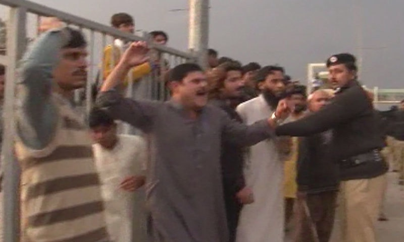 Clash between protesters and police - DawnNews screen grab