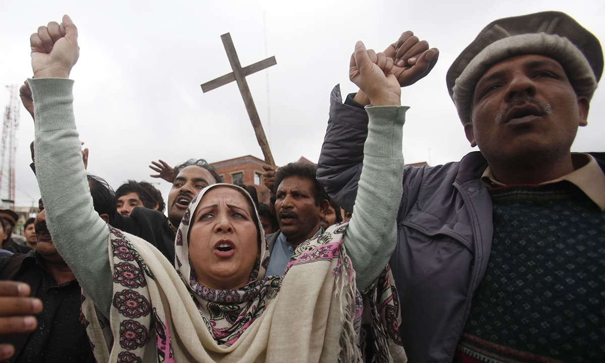 People from the Christian community attend a protest, to condemn suicide bombings which took place outside two churches in Lahore, in Peshawar. — Reuters