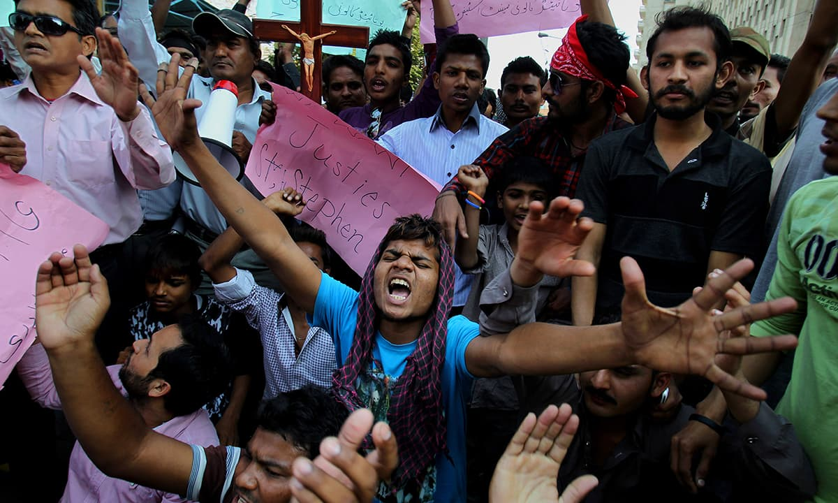 Christians chant slogans during demonstration to condemn the suicide bombing attack on two churches.— AP