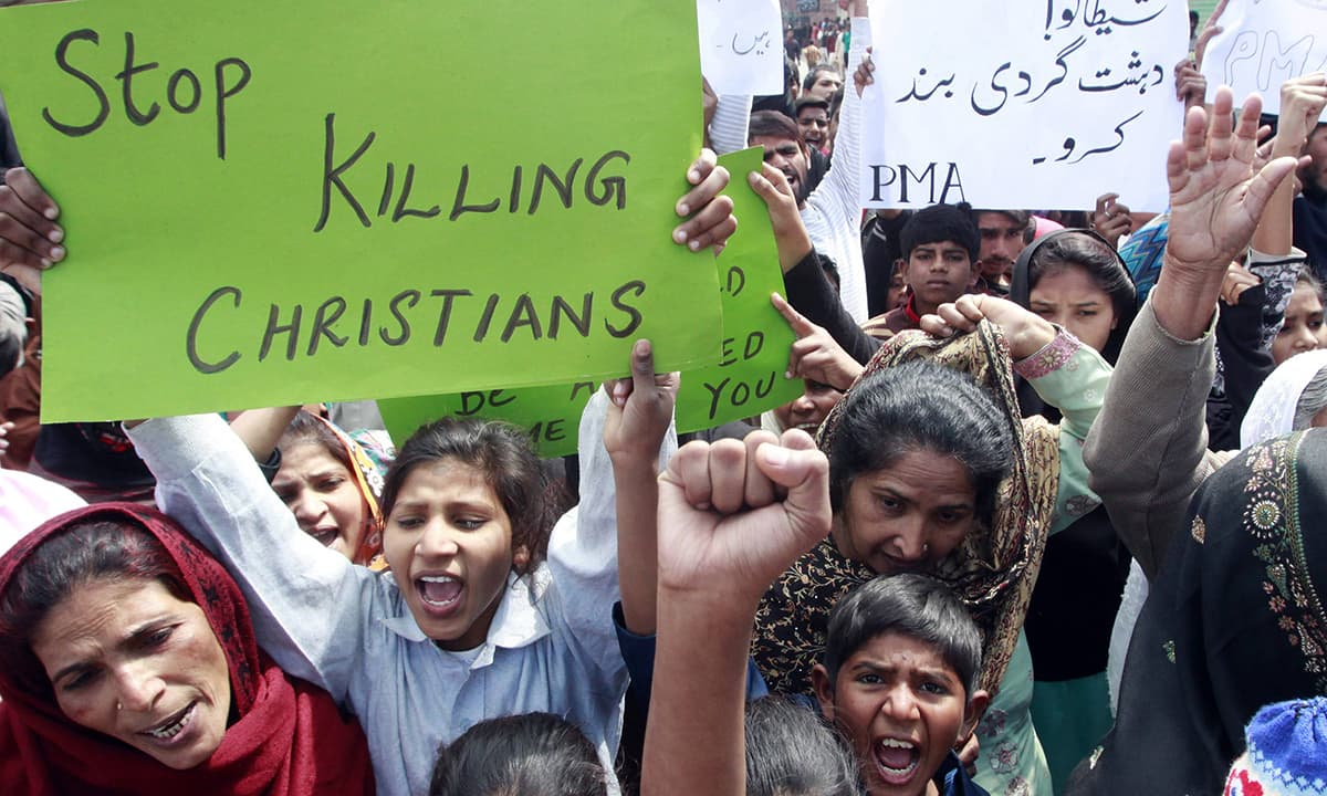 People from the Christian community attend a protest to condemn suicide bombings.— Reuters