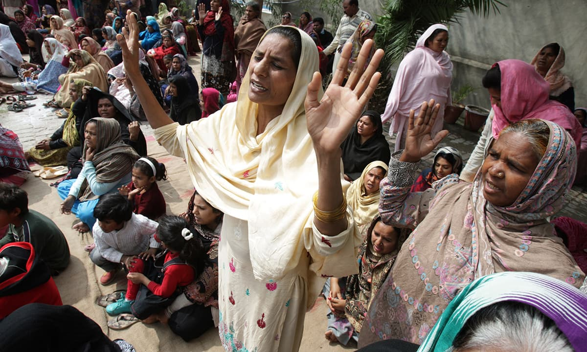 Christians pray for victims of suicide bombings that struck two churches the day before, in Lahore.— AP