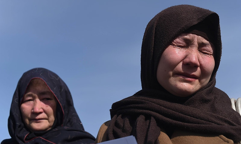 In this photograph taken on March 12, 2015, a relative of one of 30 Hazaras who were kidnapped, weeps during a gathering in Kabul. — AFP