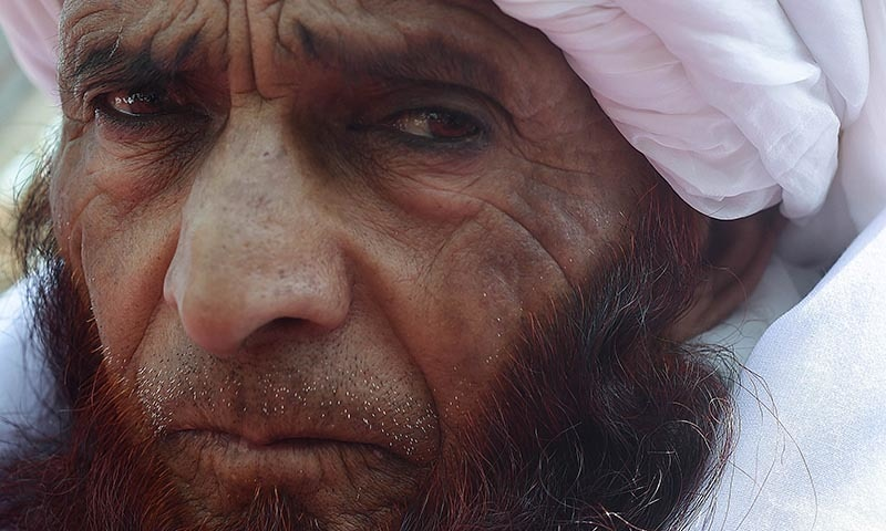 In this photograph taken on March 12, 2015, a Sufi Muslim looks on at the Bahaduria Sufi mosque in Kabul. — AFP