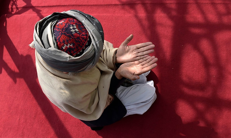 In this photograph taken on March 12, 2015, Sufi Muslims pray at the Bahaduria Sufi mosque in Kabul. — AFP