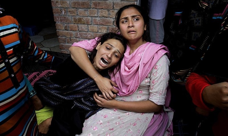 Girls mourn over a family member who was killed by a suicide bombing attack near two churches in Lahore on March 15, 2015. —AP